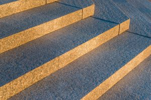 gray granite stairs in a city closeup
